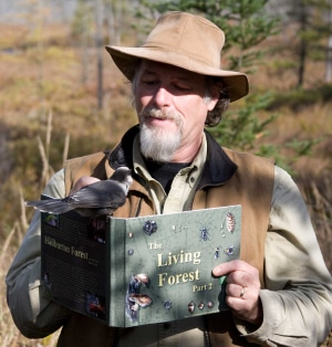 Picture of David Alexander Risk with Bird and-book - by Ben Curnaham