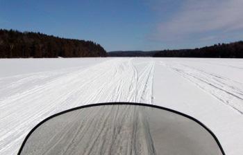 Snwomobiling on winter lake